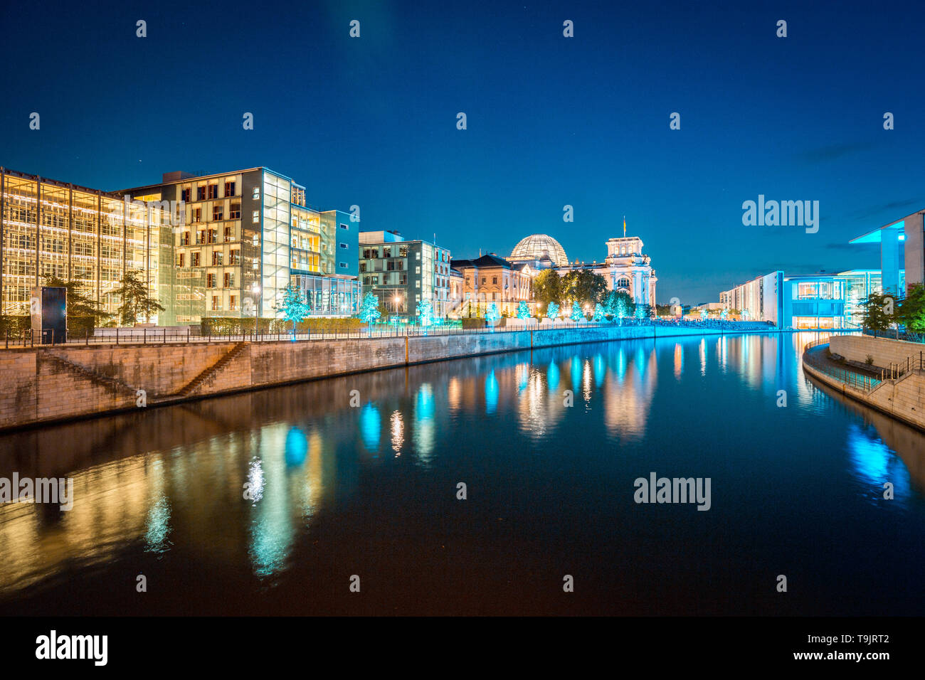 Panoramic twilight view of famous Berlin government district with Spree river during blue hour at dusk, central Berlin Mitte, Germany - Stock Image