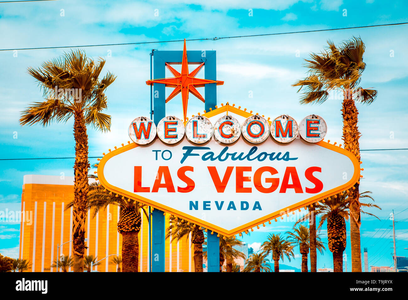 Classic view of Welcome to Fabulous Las Vegas sign at the south end of world famous Las Vegas strip on a beautiful sunny day with blue sky and clouds Stock Photo
