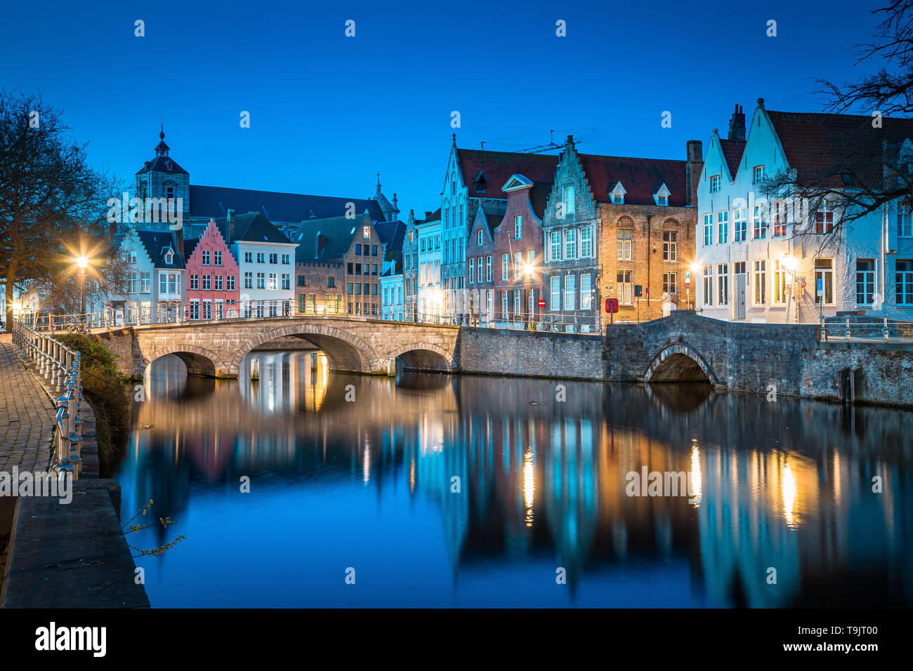 Classic panoramic twilight view of the historic city center of Brugge during beautiful evening blue hour at dusk, province of West Flanders, Belgium - Stock Image