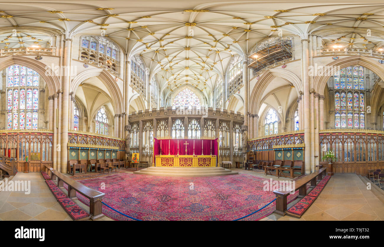 High altar and quire (choir) surrounded by stained glass windows in the medieval christian minster (cathedral) at York, England. Stock Photo
