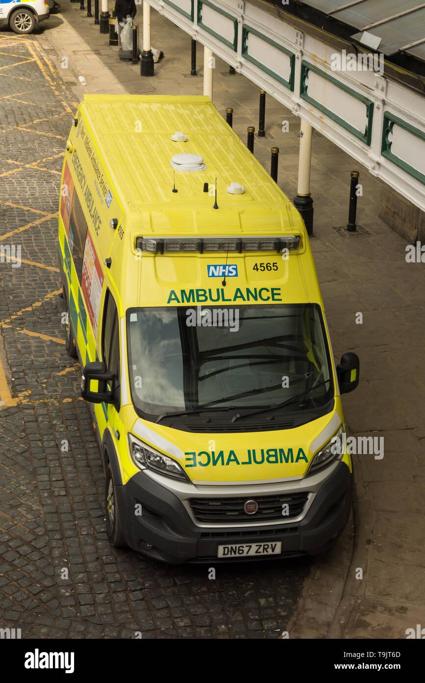British NHS Ambulance vehicle outside Shrewsbury railway station in Shropshire England - Stock Image