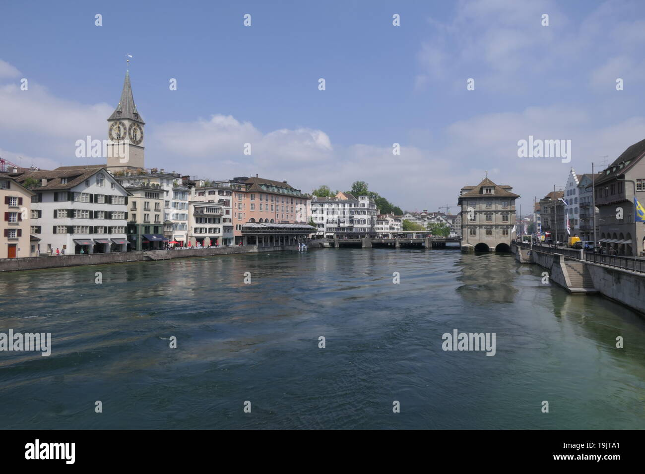 Panorama view over the oldtown of Zurich with St Peter Church, at Limmat river, Switzerland Stock Photo