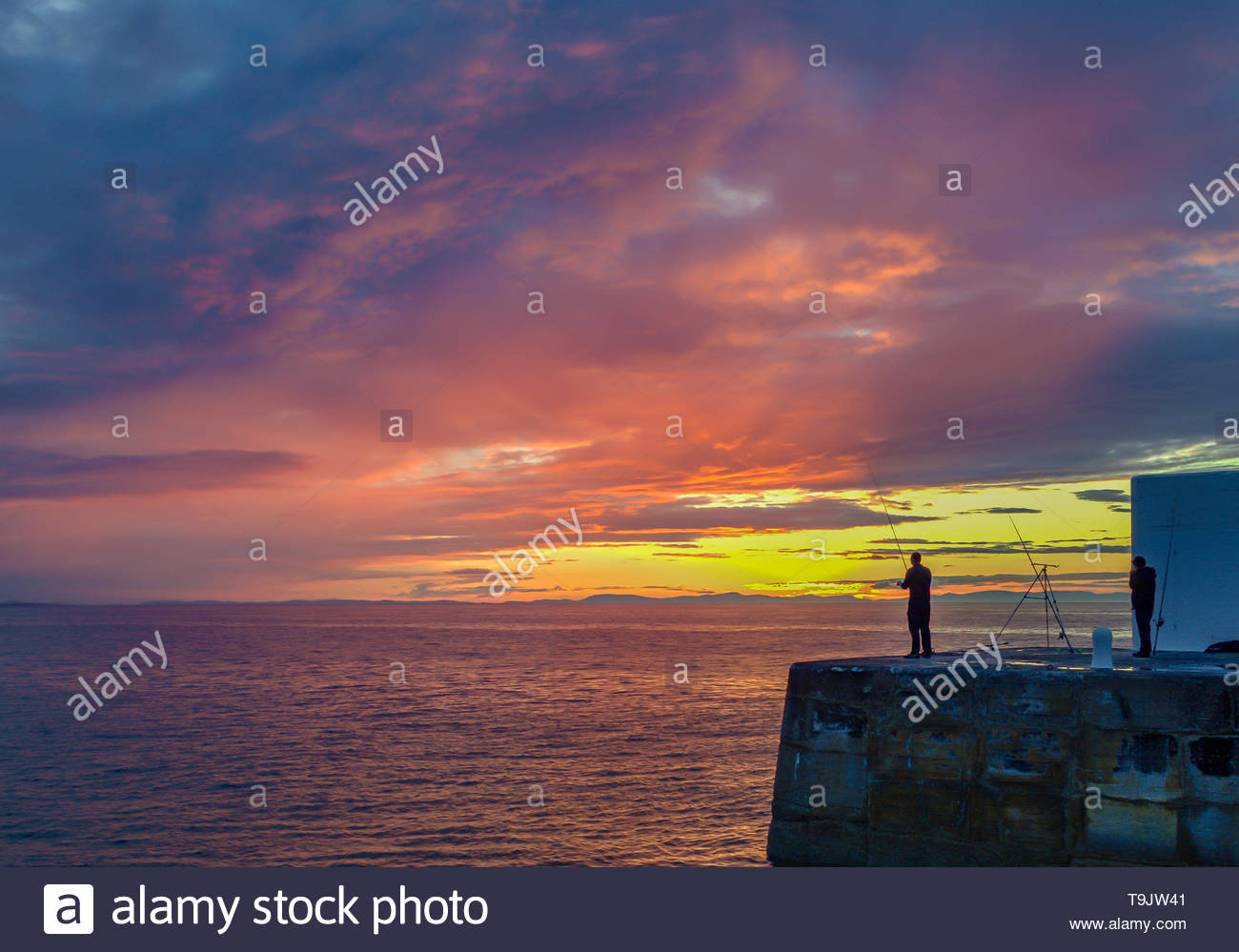 Fishing off Harbour - Stock Image