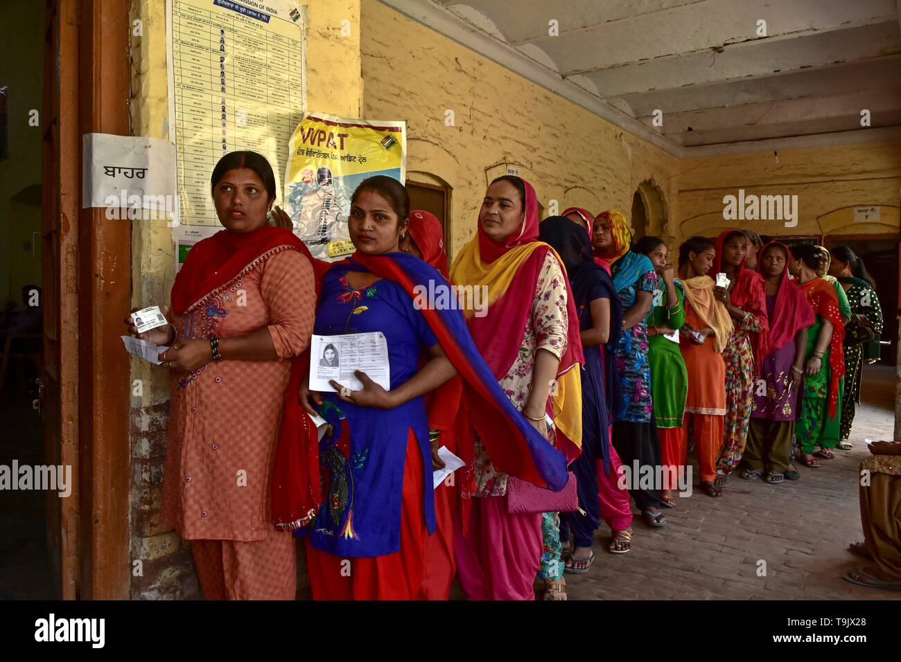Indian voters seen in a queue at a polling station during the final phase of India's general election in Patiala district of Punjab. Voting has begun for the final phase of Lok Sabha elections in Punjab, Bihar, West Bengal, Madhya Pradesh, Uttar Pradesh, Himachal Pradesh, Jharkhand and Chandigarh. Over 10.01 lakh voters will decide the fate of 918 candidates. The counting of votes will take place on May 23, officials said. - Stock Image