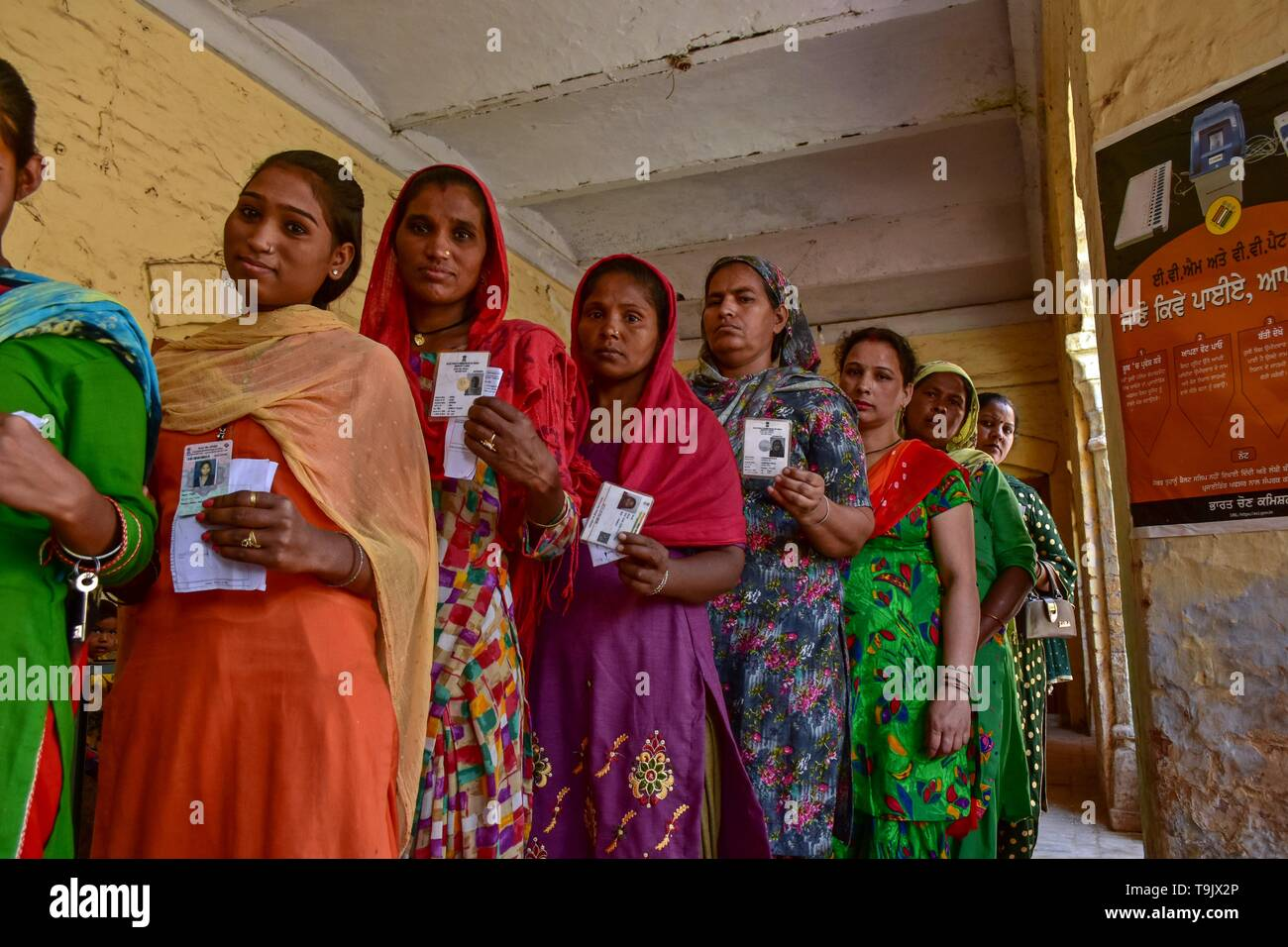 Indian women seen showing their identity cards as they queue to cast their vote at a polling station during the final phase of India's general election in Patiala district of Punjab. Voting has begun for the final phase of Lok Sabha elections in Punjab, Bihar, West Bengal, Madhya Pradesh, Uttar Pradesh, Himachal Pradesh, Jharkhand and Chandigarh. Over 10.01 lakh voters will decide the fate of 918 candidates. The counting of votes will take place on May 23, officials said. - Stock Image