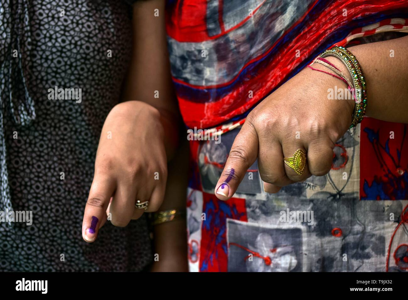 Indian voters seen showing their inked fingers after casting their vote at a polling station during the final phase of India's general election in Patiala district of Punjab. Voting has begun for the final phase of Lok Sabha elections in Punjab, Bihar, West Bengal, Madhya Pradesh, Uttar Pradesh, Himachal Pradesh, Jharkhand and Chandigarh. Over 10.01 lakh voters will decide the fate of 918 candidates. The counting of votes will take place on May 23, officials said. - Stock Image