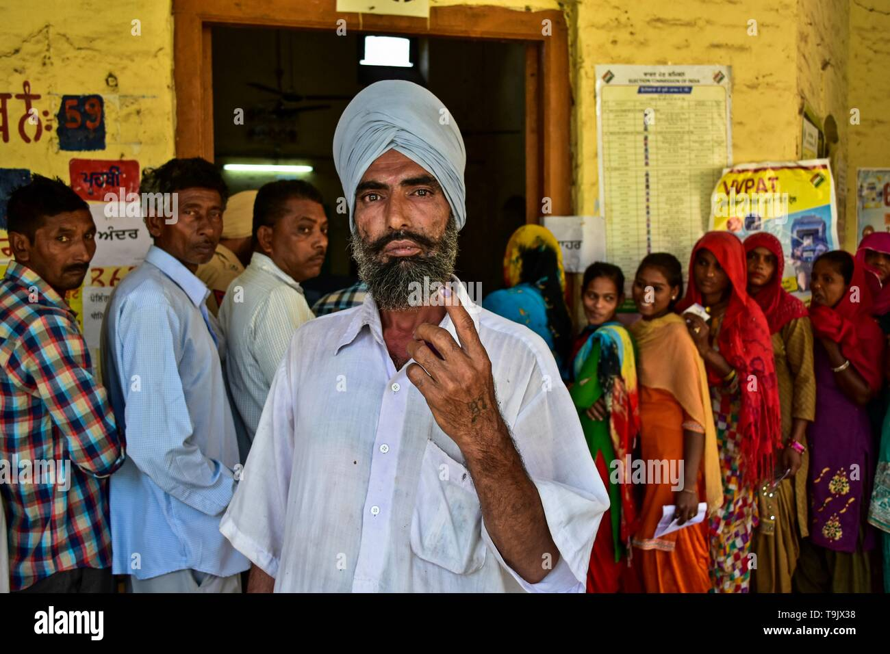 An Indian voter seen showing his inked finger after casting his vote at a polling station during the final phase of India's general election in Patiala district of Punjab. Voting has begun for the final phase of Lok Sabha elections in Punjab, Bihar, West Bengal, Madhya Pradesh, Uttar Pradesh, Himachal Pradesh, Jharkhand and Chandigarh. Over 10.01 lakh voters will decide the fate of 918 candidates. The counting of votes will take place on May 23, officials said. - Stock Image