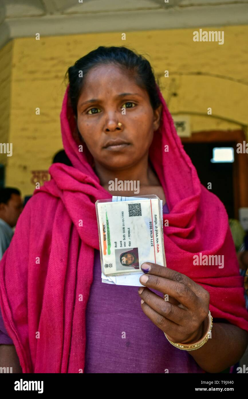 An Indian woman seen showing her identity card and ink finger after casting her vote at a polling station during the final phase of India's general election in Patiala district of Punjab. Voting has begun for the final phase of Lok Sabha elections in Punjab, Bihar, West Bengal, Madhya Pradesh, Uttar Pradesh, Himachal Pradesh, Jharkhand and Chandigarh. Over 10.01 lakh voters will decide the fate of 918 candidates. The counting of votes will take place on May 23, officials said. - Stock Image