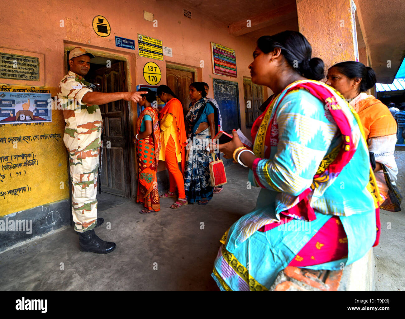 A CISF (Central Industrial Security Force) officer seen making  a gesture during the 7th Phase (Final Phase) of General Elections in Baruipur, west Bengal. Voting has begun for the 7th phase (final phase) elections in Baruipur, West Bengal. - Stock Image