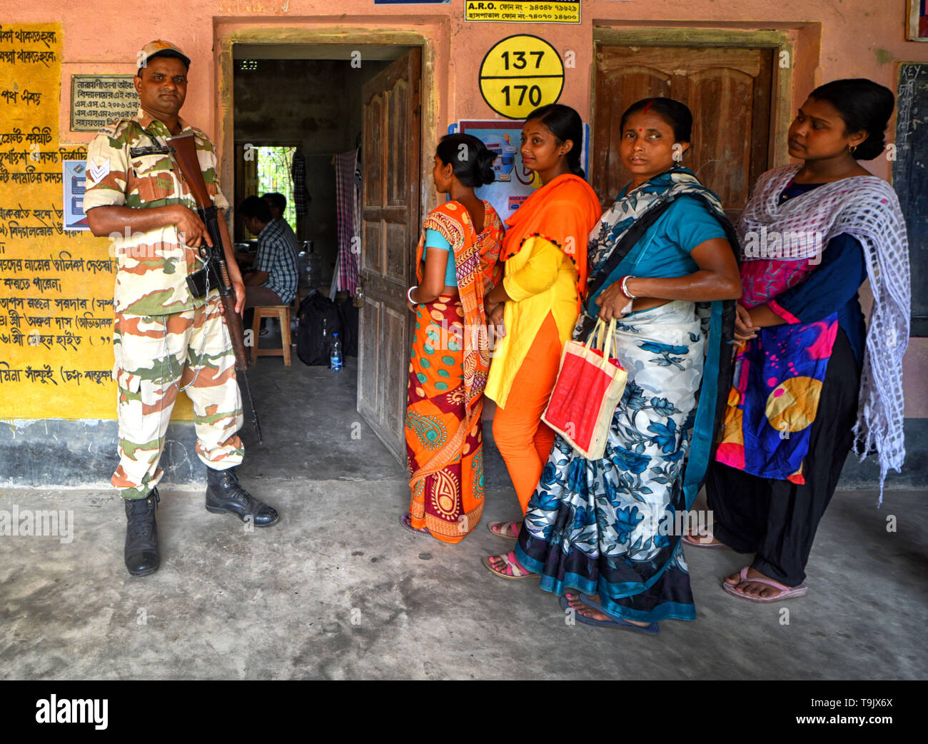 A CISF (Central Industrial Security Force) Jawan seen standing on guard at a polling station during the 7th Phase (Final Phase) of General Elections in Baruipur, west Bengal. Voting has begun for the 7th phase (final phase) elections in Baruipur, West Bengal. - Stock Image