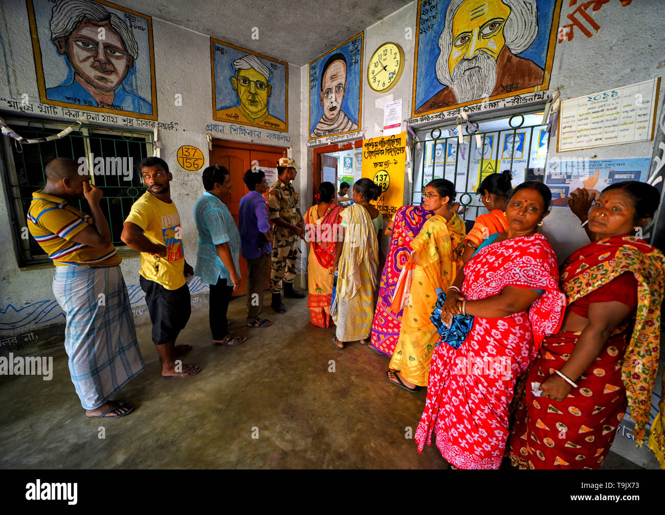 Voters seen in a queue at a polling station to cast their Votes during the 7th Phase (Final Phase) of General Elections in Baruipur, west Bengal. Voting has begun for the 7th phase (final phase) elections in Baruipur, West Bengal. - Stock Image