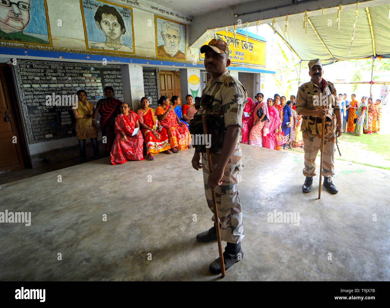 A CISF (Central Industrial Security Force) officers seen standing on guard at a polling station during the 7th Phase (Final Phase) of General Elections in Baruipur, west Bengal. Voting has begun for the 7th phase (final phase) elections in Baruipur, West Bengal. - Stock Image