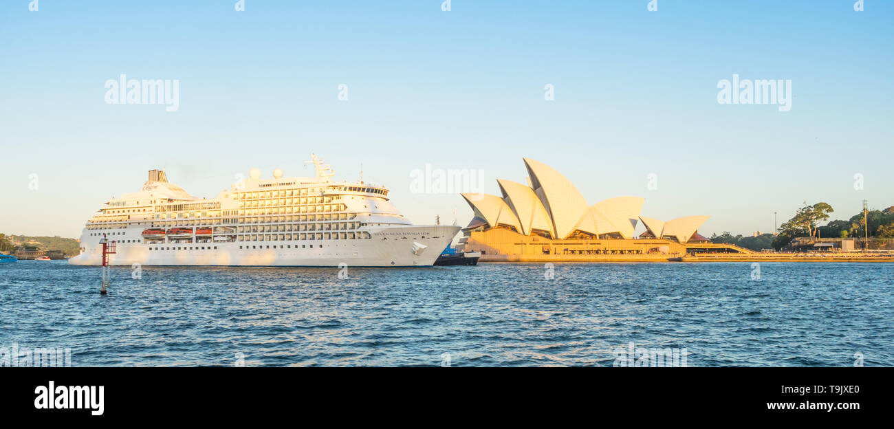SYDNEY, AUSTRALIA - FEBRUARY 11, 2019: The Seven Seas Navigator cruise liner passing Sydney Opera House  prior to docking in Sydney Harbour. - Stock Image