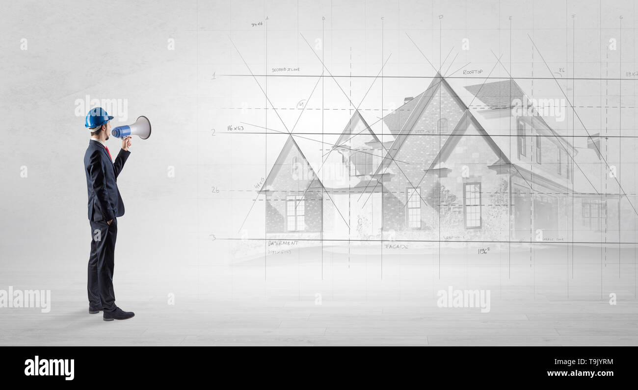 Architect standing and watching an imagined house plan  - Stock Image