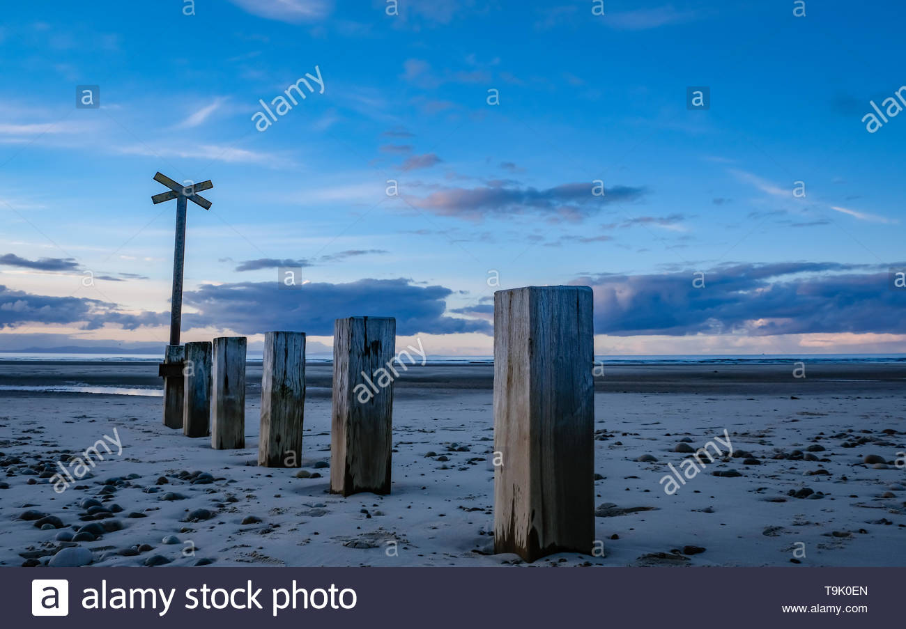 Beach post at low tide - Stock Image