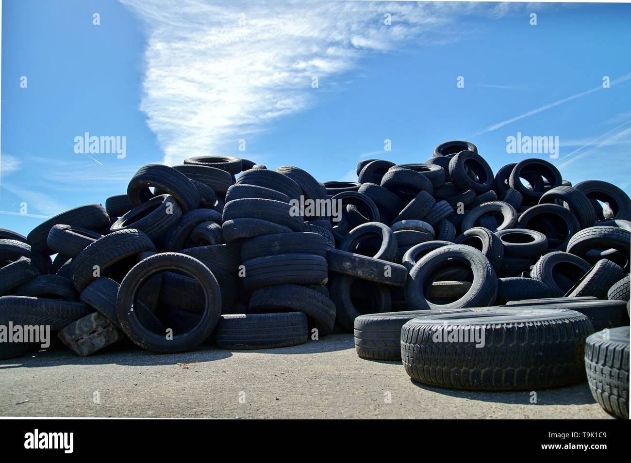 Tires Heap - Used old Tyres Many car and truck tires on dump site. Ecology background or texture concept. Scrap yard scenery. - Stock Image
