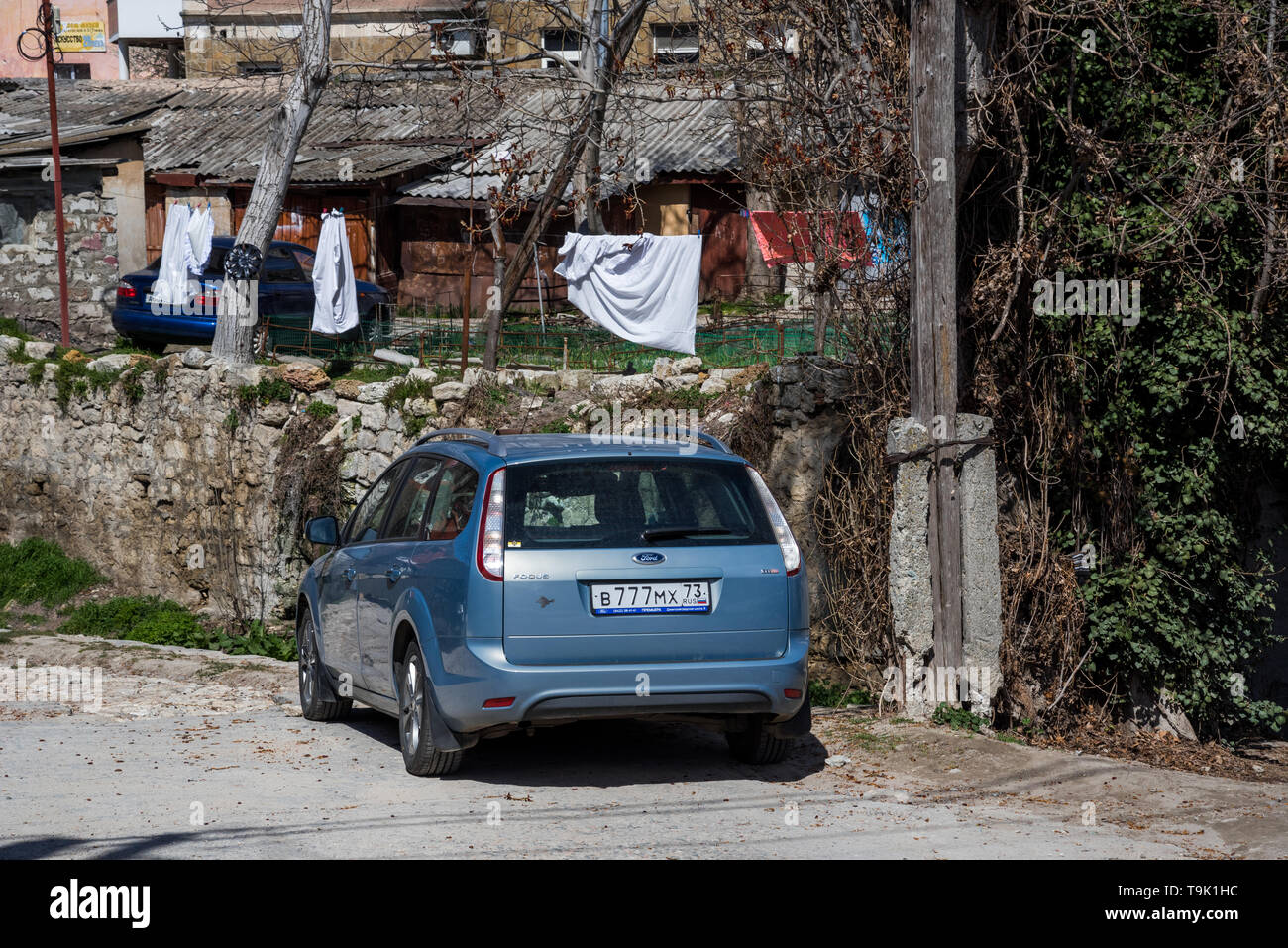Bakhchysarai, Republic of Crimea - April 1 2019 Blue car Ford Focus is parked in the courtyard of the old town Форд Фокус Крым Бахчисарай старый город - Stock Image
