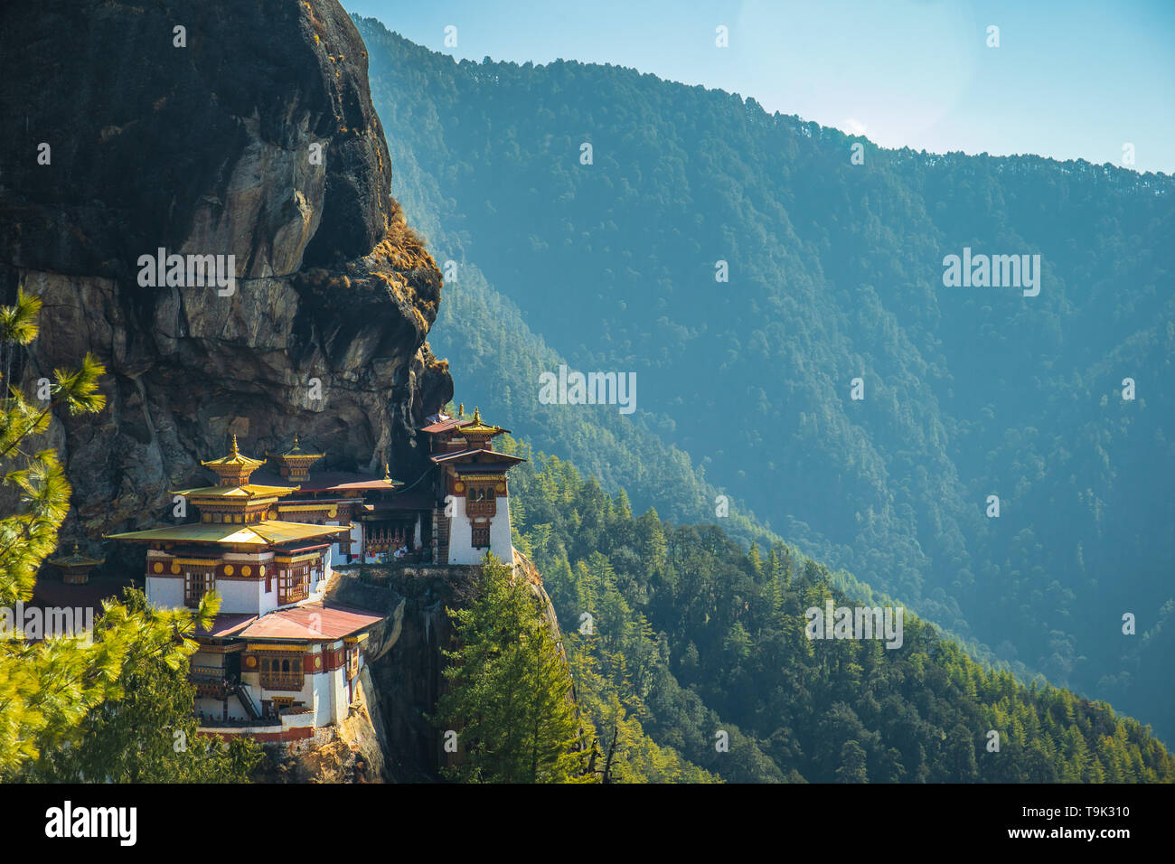 The most sacred place in Bhutan is located on the high cliff mountain with sky of Paro valley, Bhutan - Stock Image