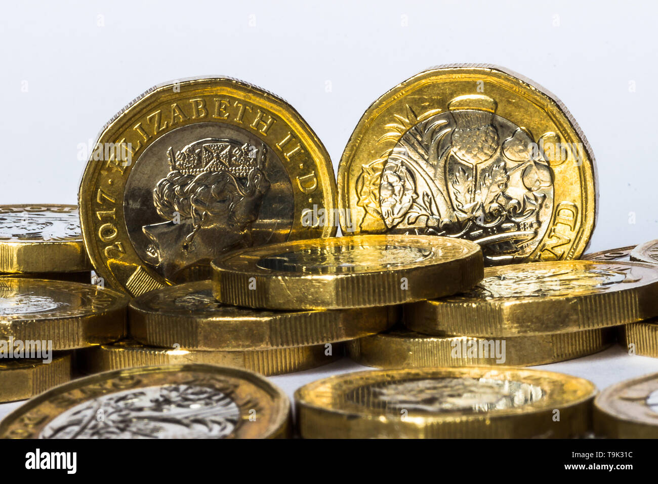 Pound coins in a pile. - Stock Image