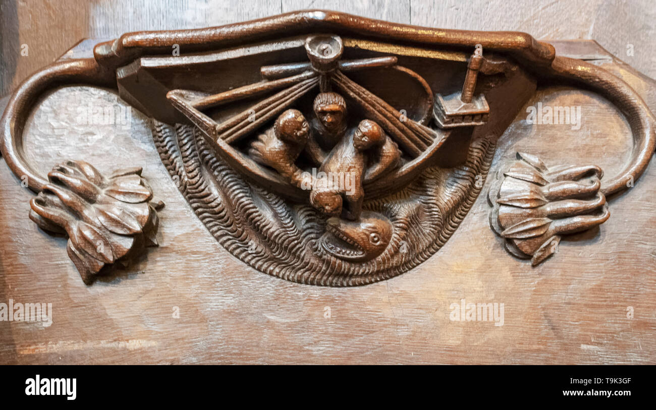 A medieval misericord depicting Jonah being thrown overboard during the storm, Ripon Cathedral, Yorkshire, UK Stock Photo