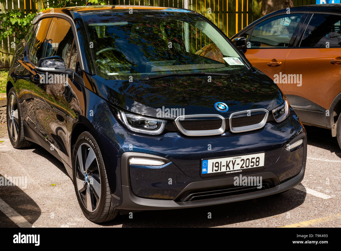 A brand new blue 2019 BMW i3 electric car automobile with Irish registration plate from County Kerry as parked on a street on sunny day. - Stock Image