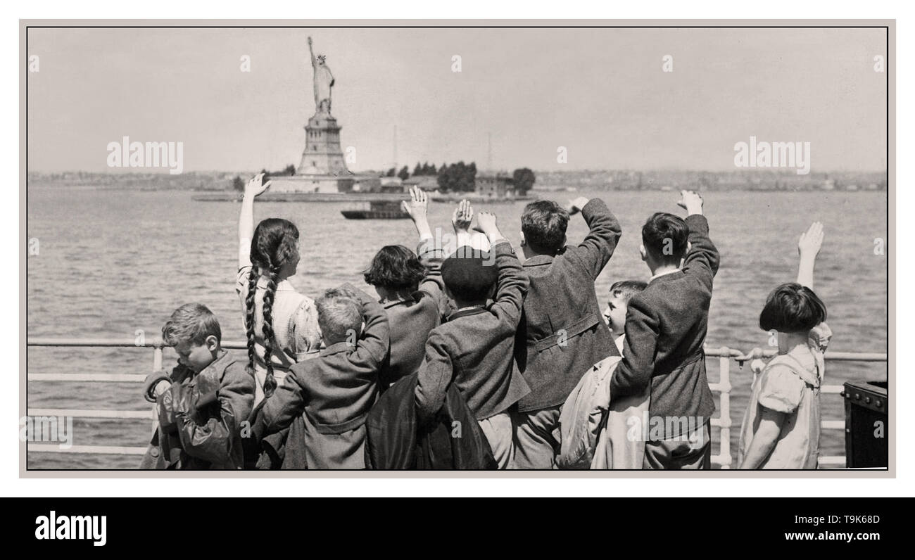 Vintage archive WW2 Propaganda image of Jewish refugee children escaping Nazi Germany anti Semitic aggression by traveling by sea to the United States in 1939. Jewish children mimic and wave to the Statue of Liberty as they enter New York on the SS President Harding on 3 June 1939 - Stock Image