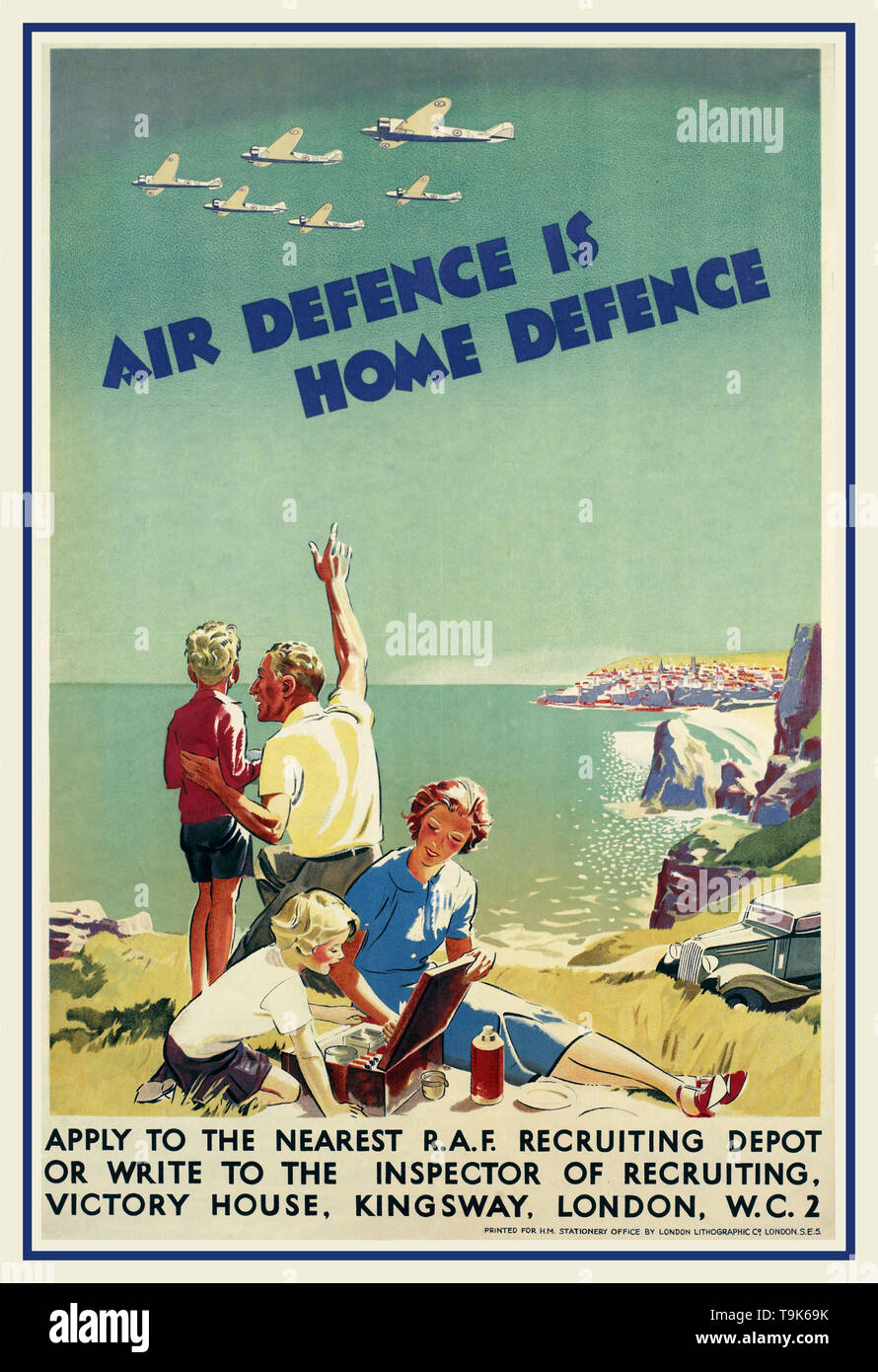 "Vintage 1940's  WW2 Propaganda recruiting poster for the RAF  'Air Defence is Home Defence' Family having a picnic on a cliff top by the sea. The mother and daughter sit with a hamper, while the father points out to his son six RAF aircraft passing in formation overhead. The family's car is parked in the background, and a small town is visible in the distance across the bay. ""AIR DEFENCE IS HOME DEFENCE""  APPLY TO THE NEAREST R.A.F. RECRUITING DEPOT OR WRITE TO INSPECTOR OF RECRUITING, VICTORY HOUSE, KINGSWAY, LONDON, W.C.2 PRINTED FOR H.M. STATIONERY OFFICE - Stock Image"