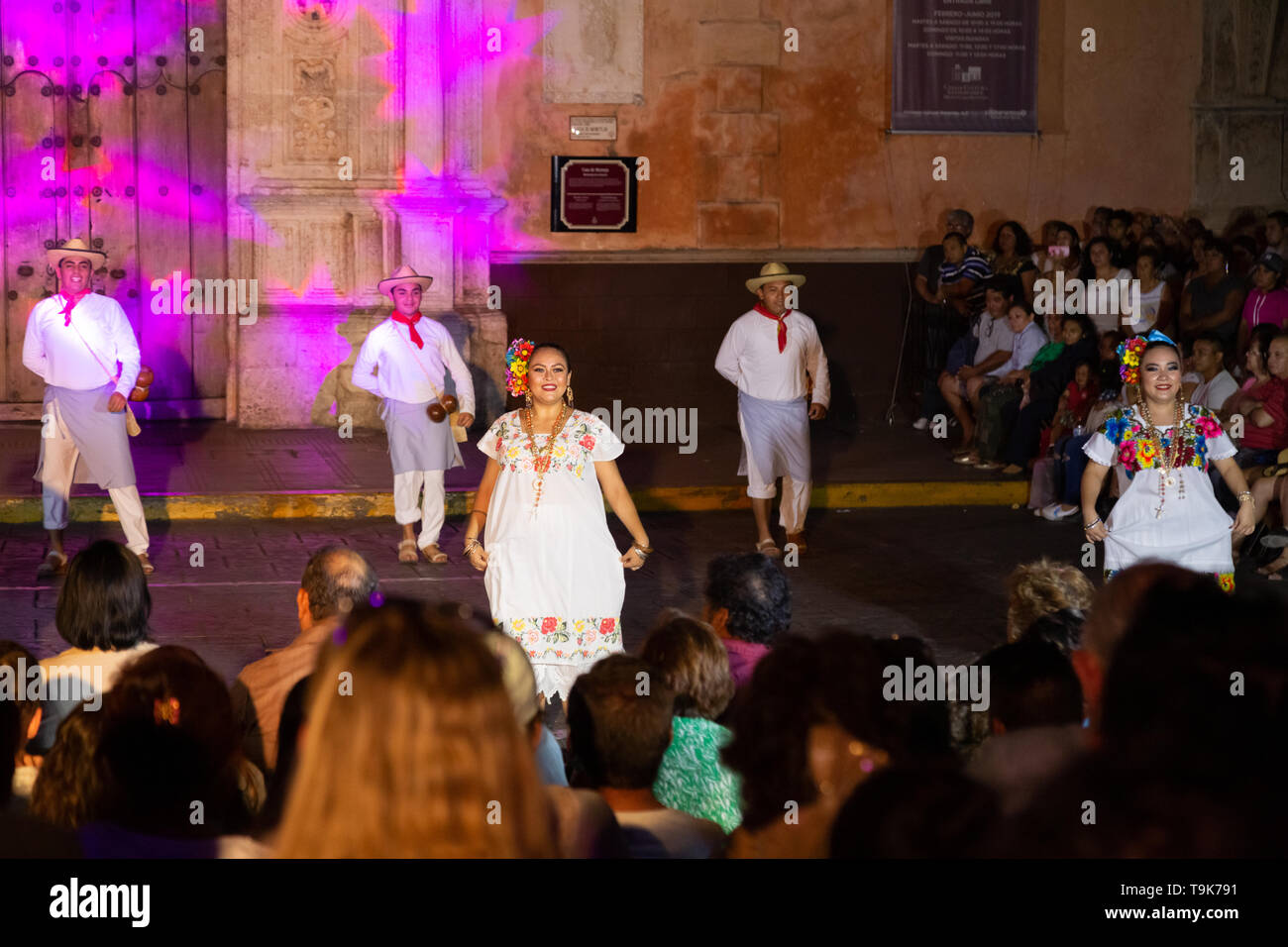 Merida Mexico - dancing show in the street at night by dancers in traditional costume; Merida, Mexico, Latin America - Stock Image