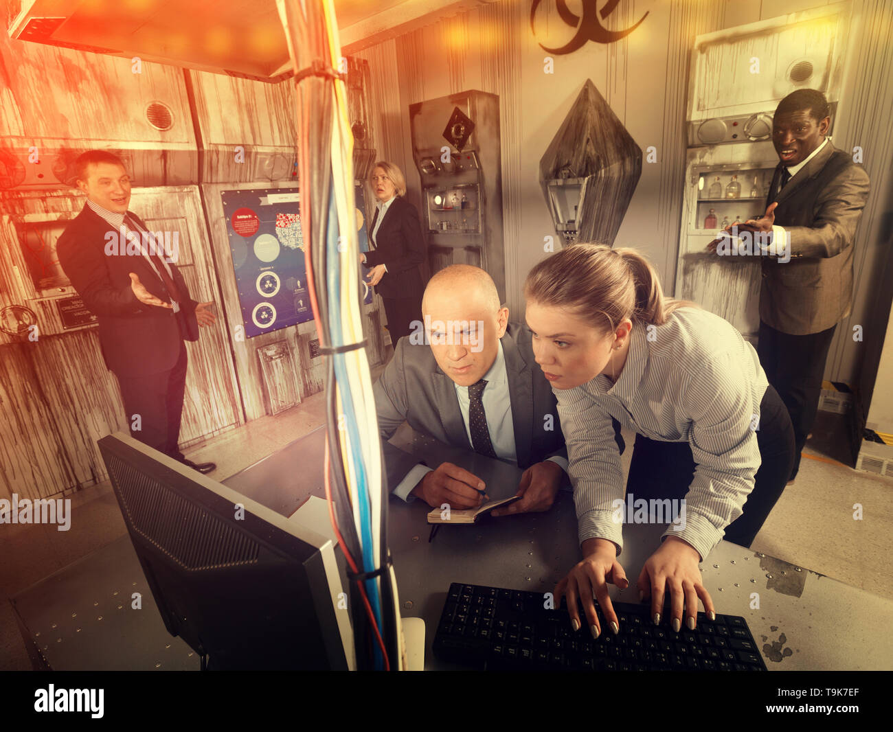 Toned image of businesspeople trying to get out of escape room stylized under laboratory. Concept of finding business solutions - Stock Image