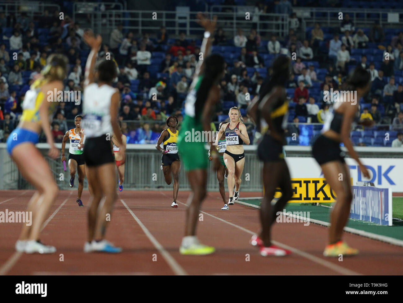 YOKOHAMA, JAPAN - MAY 10: Madeline Price of Canada races down the home straight in the women's 4x400m relay during Day 1 of the 2019 IAAF World Relay Championships at the Nissan Stadium on Saturday May 11, 2019 in Yokohama, Japan. (Photo by Roger Sedres for the IAAF) - Stock Image