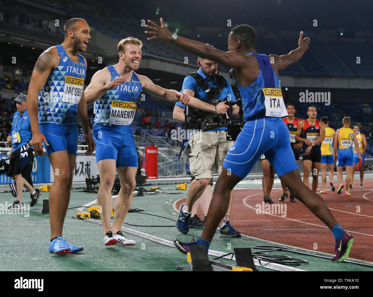 YOKOHAMA, JAPAN - MAY 10: the Italians celebrate after the mens 4x100m relay during Day 1 of the 2019 IAAF World Relay Championships at the Nissan Stadium on Saturday May 11, 2019 in Yokohama, Japan. (Photo by Roger Sedres for the IAAF) - Stock Image