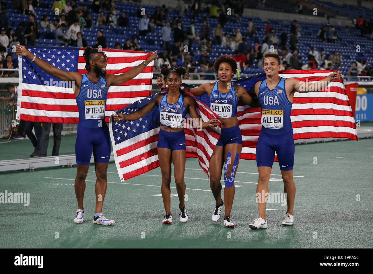 YOKOHAMA, JAPAN - MAY 10: Freddie Crittenden, Christina Clemons, Sharika Nelvis and Devon Allen of the USA after they won the mixed shuttle hurdles relay final during Day 1 of the 2019 IAAF World Relay Championships at the Nissan Stadium on Saturday May 11, 2019 in Yokohama, Japan. (Photo by Roger Sedres for the IAAF) - Stock Image