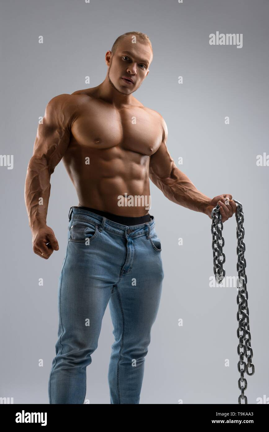 Strong guy with chain looking at camera - Stock Image