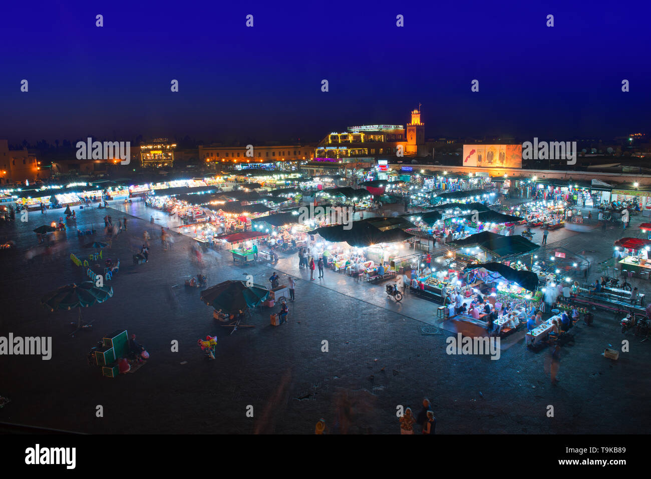 Marrakech, Morocco - May 11 2019: Jema Eel-fna Square seen at night, full of life and activities, tourists, merchants, restaurants, stalls. Stock Photo