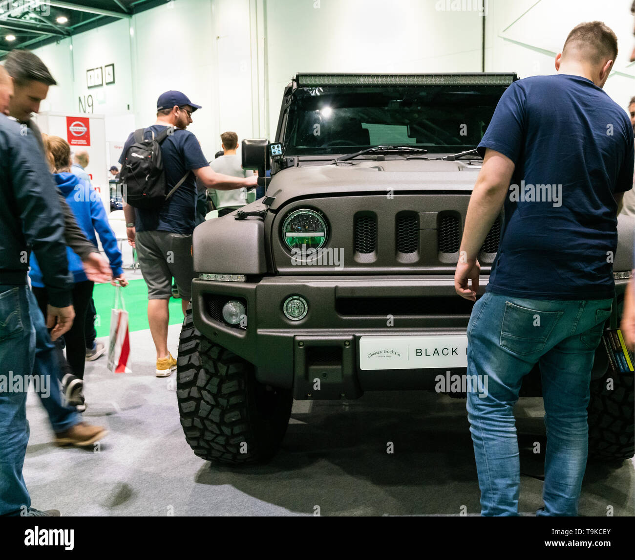 18th May 2019. London, UK. Men showing interest in Wrangler Jeep Black Hawk Wide Body edition at London Motor Show 2019 - Stock Image