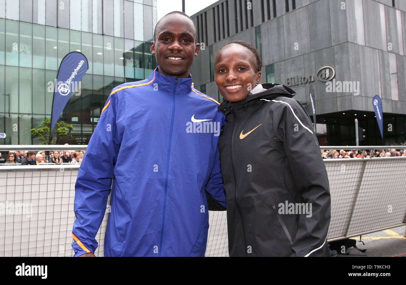 Jacob Kiplimo (left) and Helen Obiri pose together after winning their respective Elite races during the Simply Health Manchester Run. - Stock Image