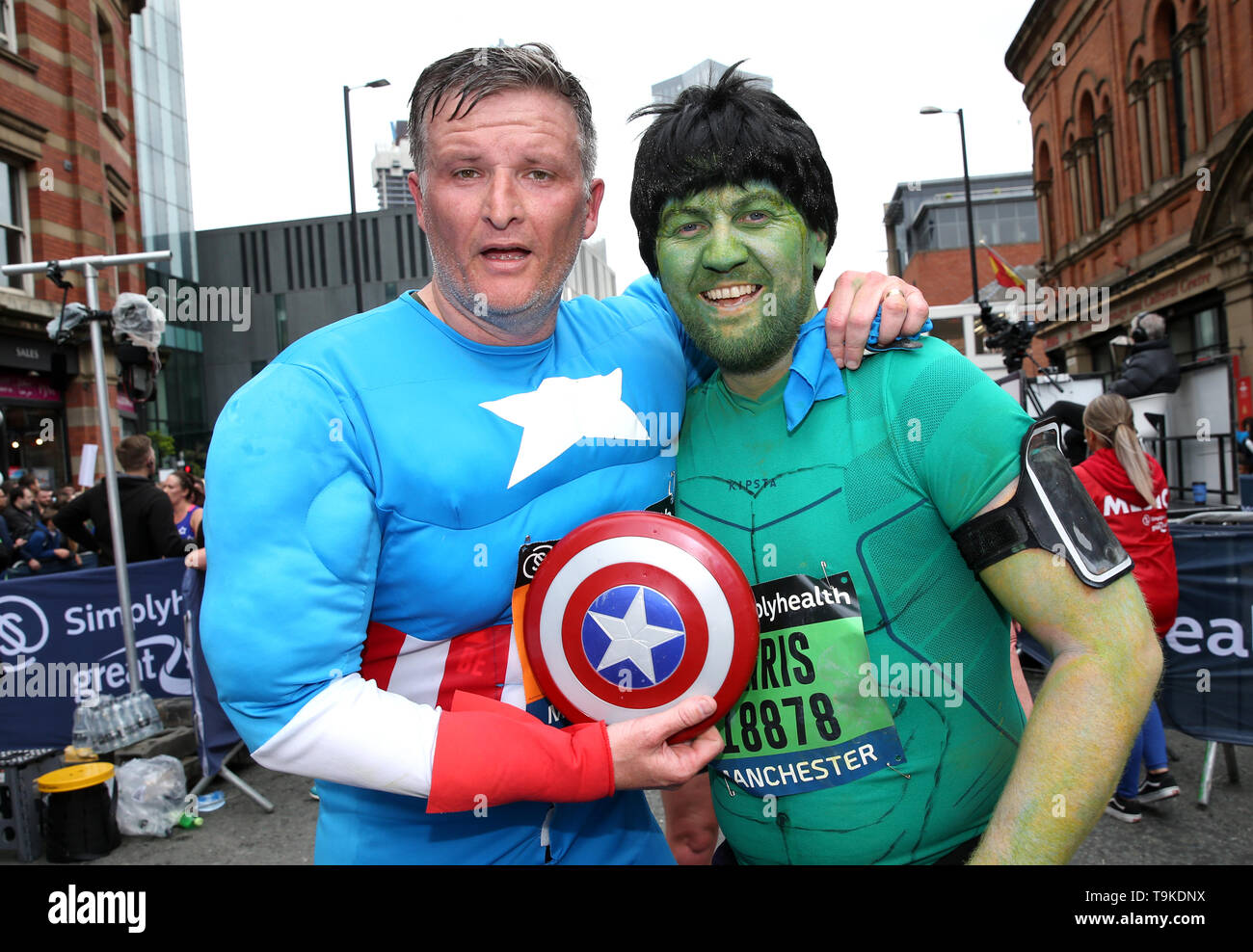 Runners in fancy dress after completing the Simply Health Manchester Run. Stock Photo