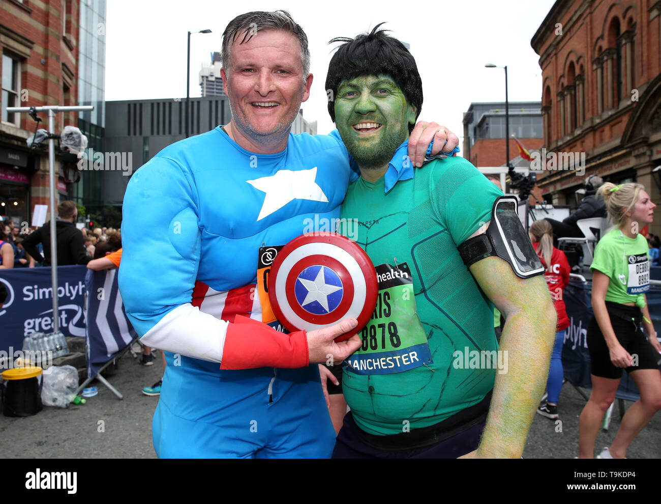 Runners in fancy dress after completing the Simply Health Manchester Run. - Stock Image