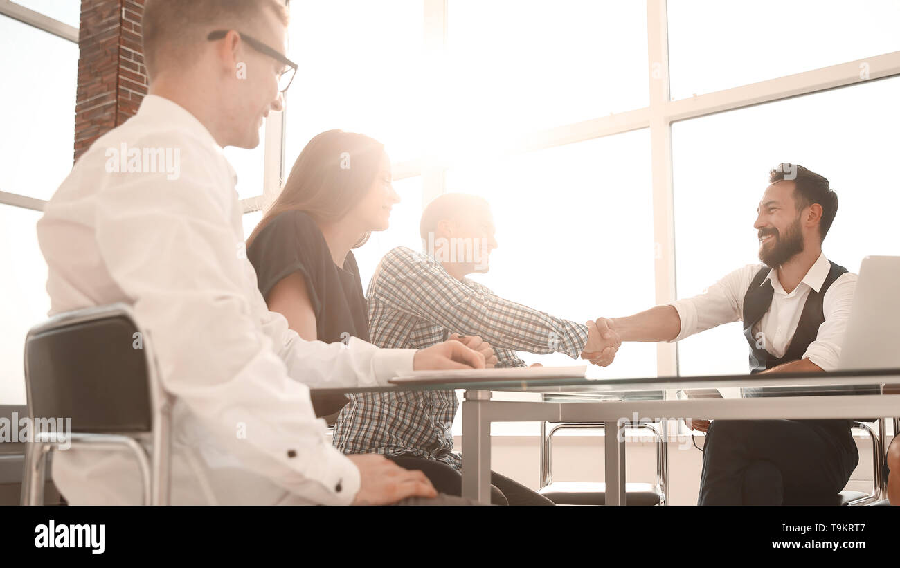 business partners shake hands during a working meeting.the concept of cooperation - Stock Image