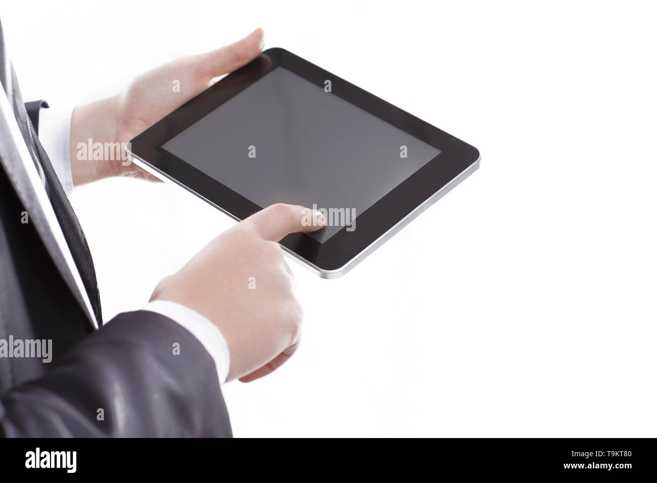 close up.businessman tapping the screen of the digital tablet.photo with copy space - Stock Image