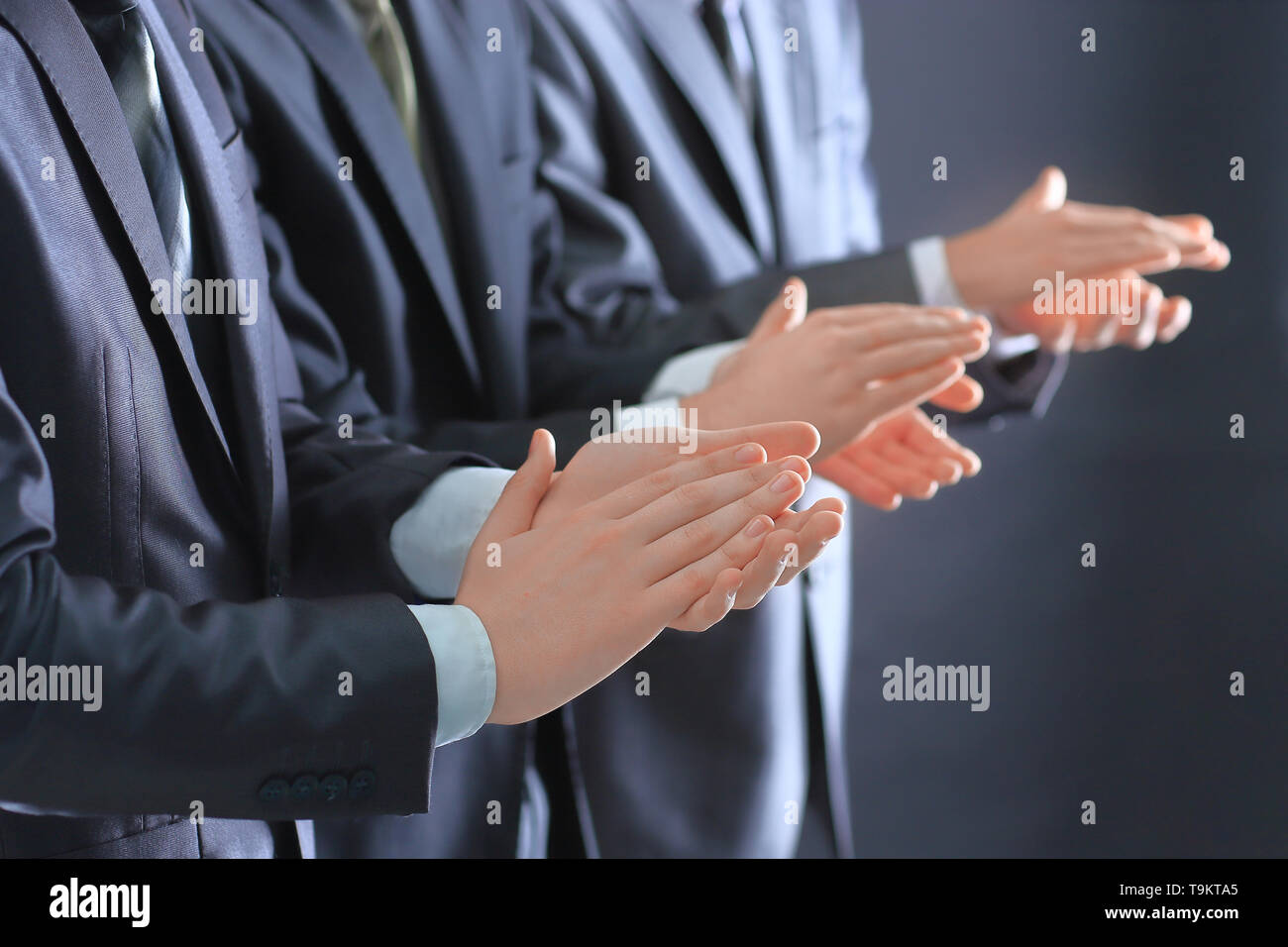 close up.a group of business people applauding standing. success concept - Stock Image