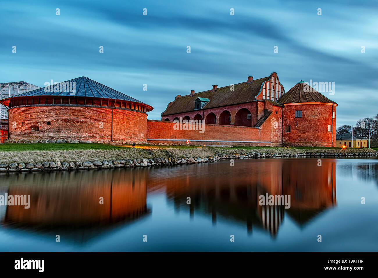 After the sun has set, Landskrona citadel looks beautiful in the blue hour light. Stock Photo