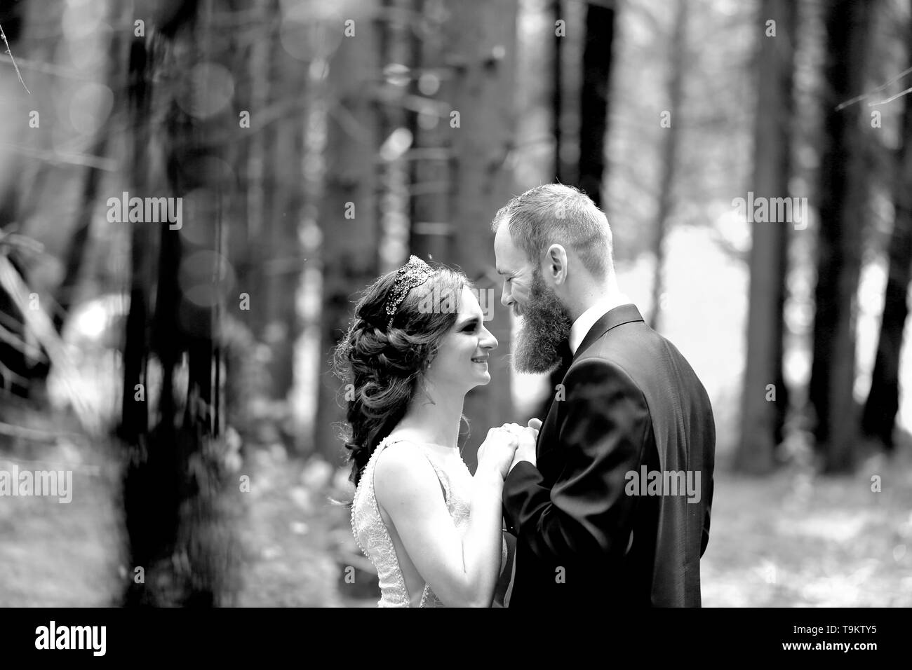 beautiful in love couple looking at each other. - Stock Image