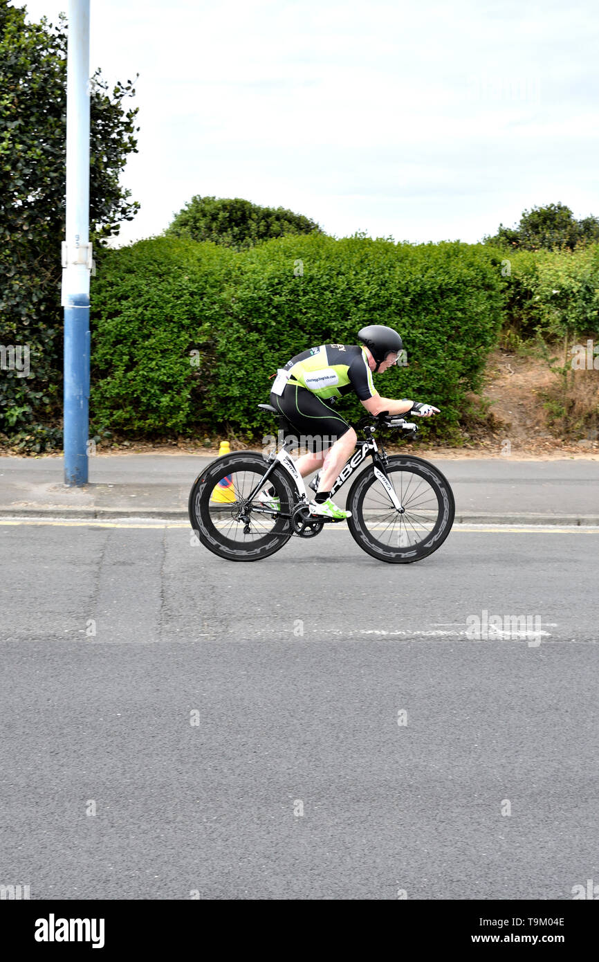 May 19th 2019 St AnnesTriathlon. Male and female triathletes competing in the cycling part of the event. - Stock Image