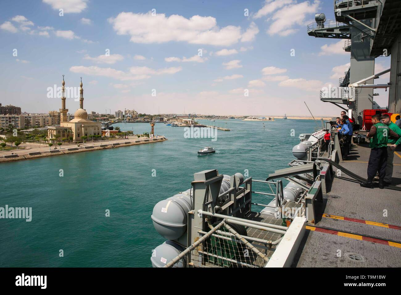 View of a mosque from onboard the U.S. Navy Nimitz-class aircraft carrier USS Abraham Lincoln as it transits the Suez Canal May 9, 2019 in the Suez, Egypt. The aircraft carrier is part of additional forces being sent to the Middle East to counter what the Trump administration calls clear indications of threats from Iran. - Stock Image