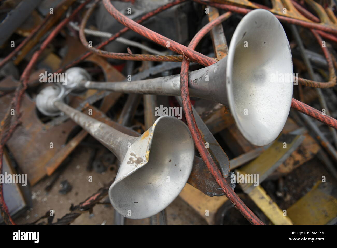 Scrap metal recycling, semi truck horns in a pile of discarded materials for recycling in the USA. - Stock Image