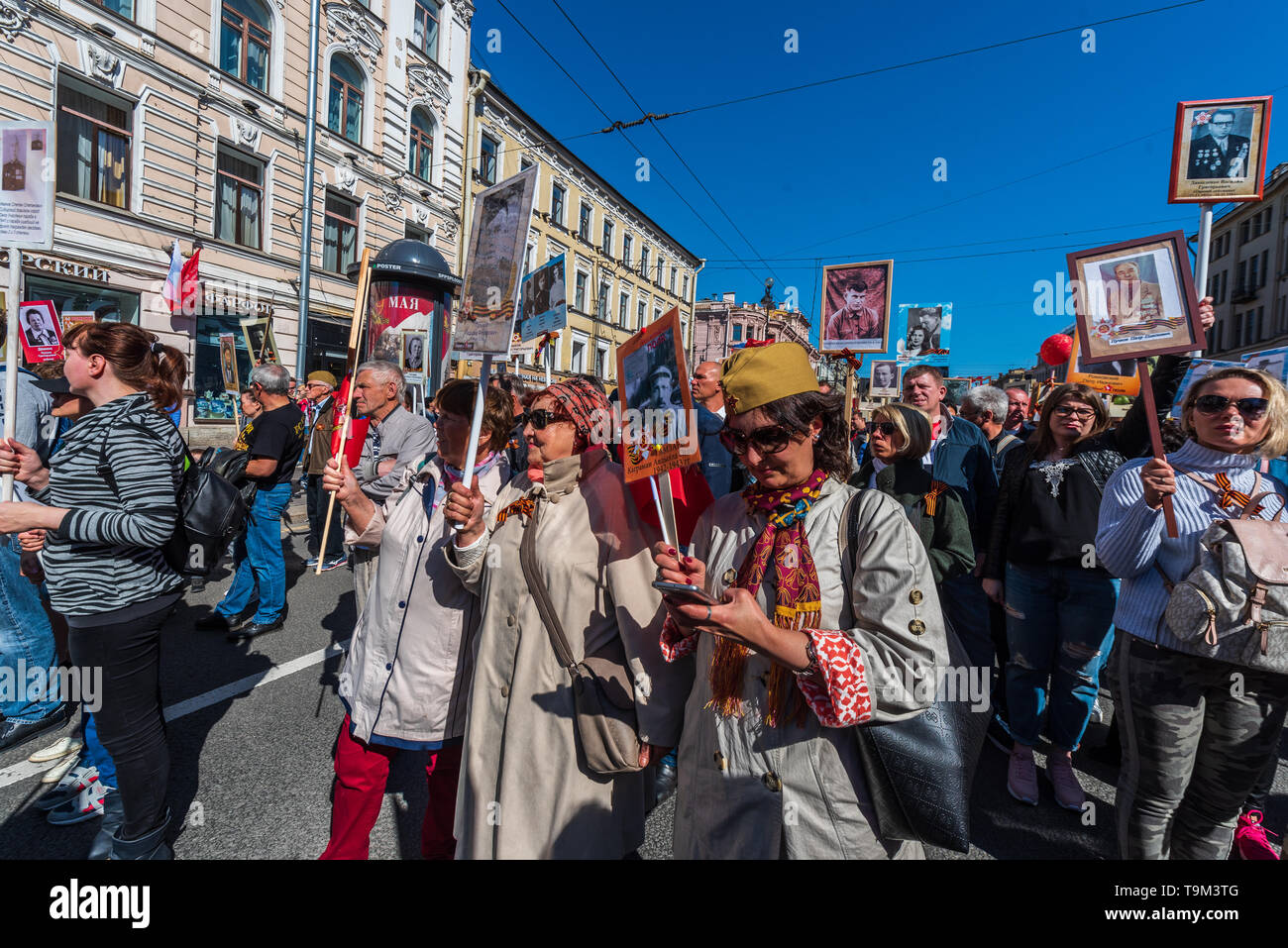 Immortal regiment - people carry banners with a photograph of their warrior ancestors, Victory Day, Nevsky Prospect, St. Petersburg, Russia - Stock Image