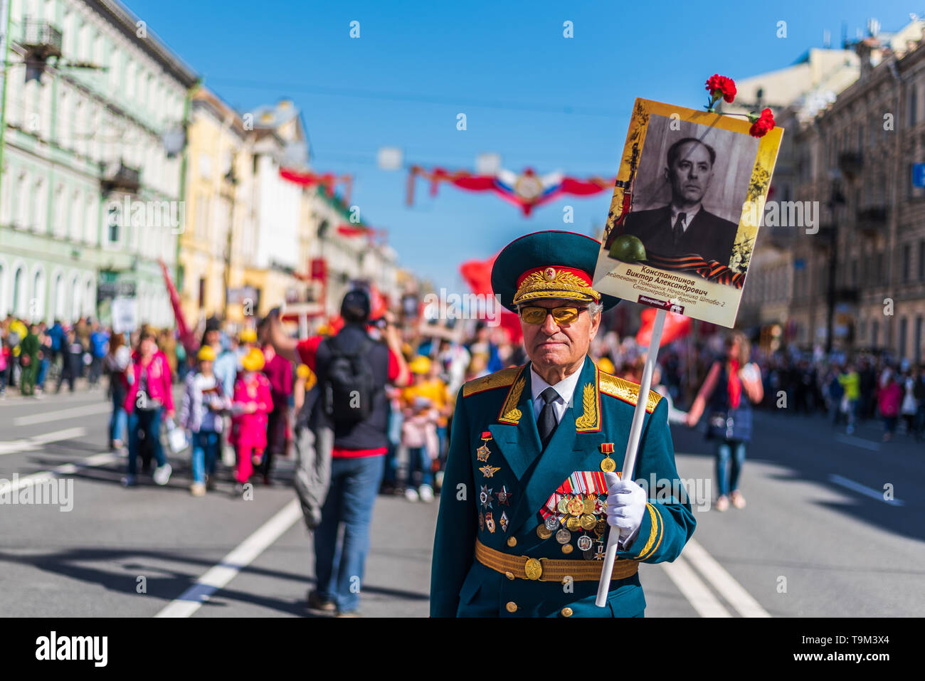 Immortal regiment - Veteran people carry banners with a photograph of their warrior ancestors, Victory Day, Nevsky Prospect, St. Petersburg, Russia - Stock Image