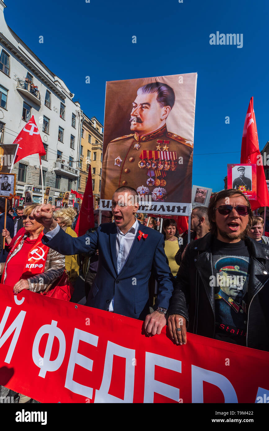 Immortal regiment - Comunist party carry banners with a photograph of their warrior ancestors, Victory Day, Nevsky Prospect, St. Petersburg, Russia - Stock Image