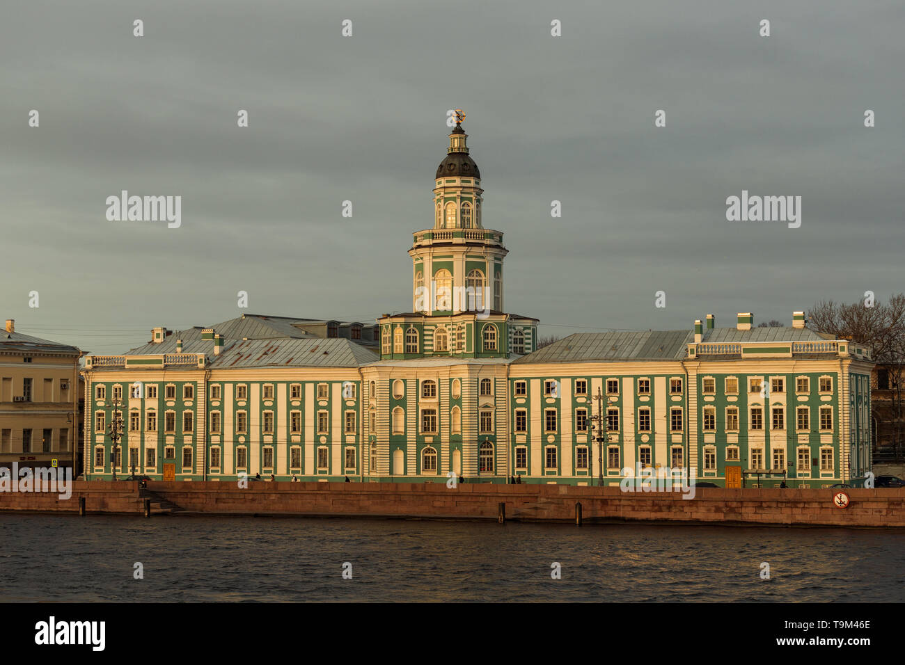 View of the Kunstkamera in Saint Petersburg from across Neva river during sunrise on a winter day (St. Petersburg, Russia, Europe) - Stock Image